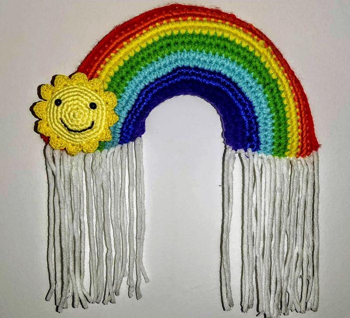Patrón gratis arcoiris sol y lluvia
